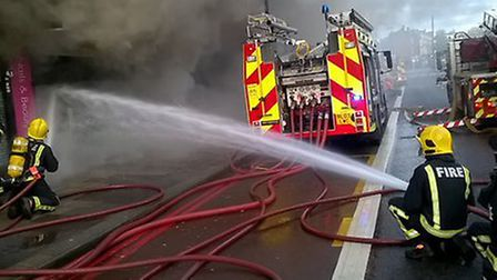 Firefighters tackle the blaze in Finchley Road this morning