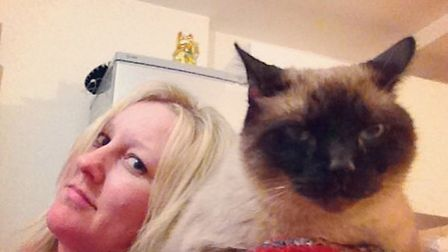 Meshell Boyle with her Siamese rescue cat Griffith