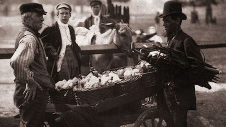 Victorian 'Mush-Fakers' and ginger beer makers with their cart (Photo by John Thomson/Hulton Archive