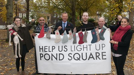 The Save Our Lights team are fundraising to save the festive lights in Pond Square. Picture: Nigel S