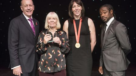 Clissold Park Junior Tennis Club founder Jan Coombs (second from left) was honoured at the Hackney S