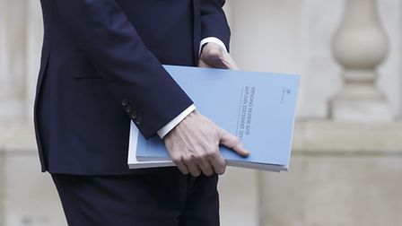 Chancellor of the Exchequer George Osborne leaves the Treasury in London for the House of Commons, w