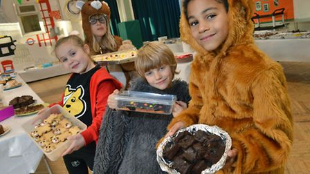 Pupils Brooke, Alex, Abe and Tiko at the Gospel Oak School bake sale for Children in Need. Picture: