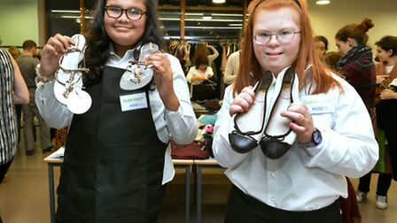 Swiss Cottage School pupils Eve and Layla,14, with items for sale at the Glam Party. Picture: Nigel