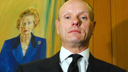 Mike Freer beside the portait of Margaret Thatcher in Portcullis House. Picture: Polly Hancock.