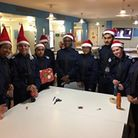 Police cadets at Stoke Newington station wrap up the presents