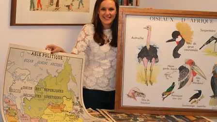 Harriet Parker with a selection of the Rossignol posters she is selling at the Hampstead Pop Up Vint