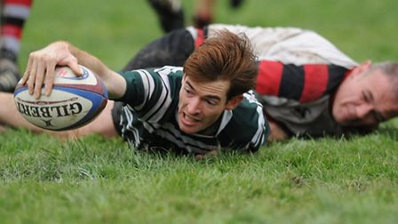Mike Evans-Jones reaches over the try-line to score for Hendon. Pic: Paolo Minoli
