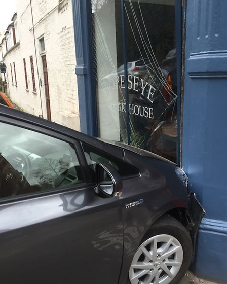 A car smashed into the new Popes Eye Steak House restaurant in Highgate Hill on Saturday. Picture: M