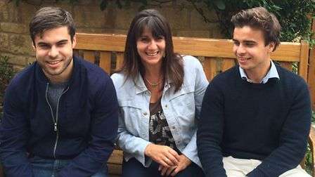 Thomas (right) with his mum Sarah and his brother