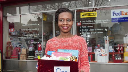 Yolanda Kenyi with the first gift as part of Highgate's live advent calendar project at Postal Plus