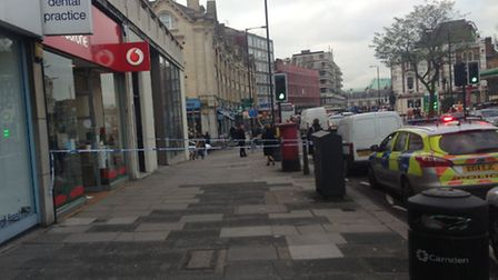 Police cordoned off the pavement outside the Vodafone store in Finchley Road