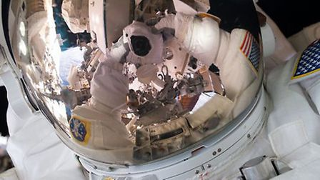 Expedition 45 Commander SCOTT KELLY took this selfie photograph during a 7-hour and 16-minute spacew