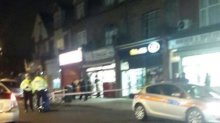 Police cordon off William Hill shop in Dunsmure Road. Picture: 999London