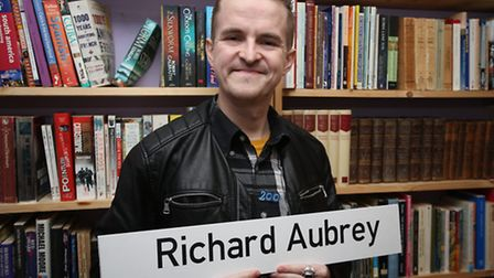 Richard Aubrey holding his Only Connect name card