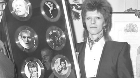 David Bowie at Rules Restaurant after receiving a presentation of six discs from RCA Records to mark