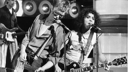 Herbie Flowers playing bass behind David Bowie and Marc Bolan in this shot by an unknown photographe