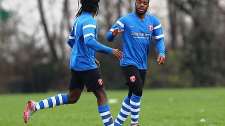 Sammy Anjorin (right) celebrates Highfield's first goal in their Albert Daniels Senior Cup victory o