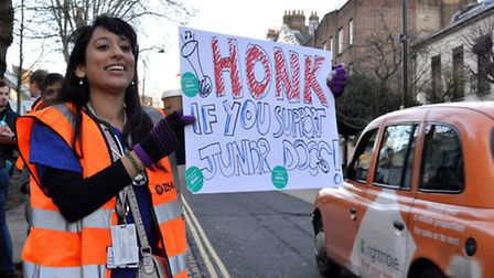 Striking junior doctors with signs outside the Royal Free Hospital in Hampstead on 12.01.15. Picture