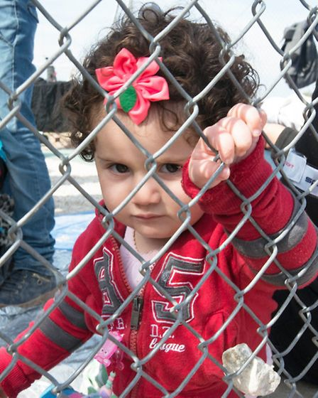 A child refugee in Lesbos. Picture: Doug Kuntz