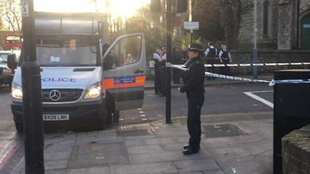 Police outside the scene of the stabbing on Tuesday (Picture: @cycleoptic / Twitter)