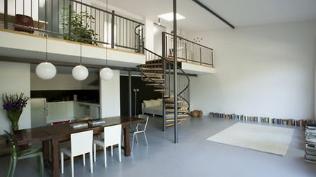 A mezzanine can be built in a room with high ceilings and can free up space for all sorts of uses. P