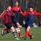 FC Bartlett (stripes) beat Shakespeare 2-0 in the Dickie Davies Cup. Pic: Gavin Ellis/TGS Photo