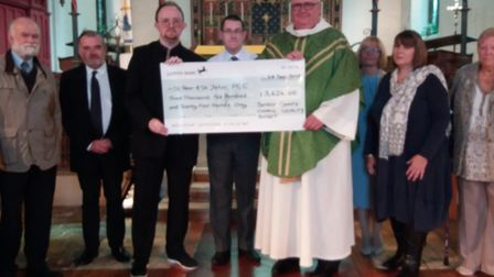 Suffolk county councillor Jamie Starling presents a cheque for £3,624 toRev Eoin Buchanan, of the St Peter & St John...