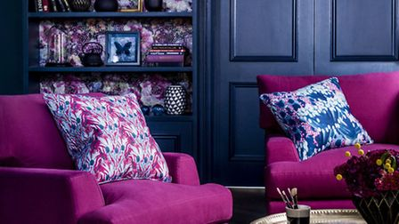 Be adventurous with sofa upholstery, especially if contrasted with dark walls, and furniture will re