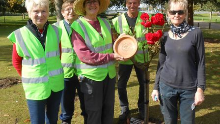 Some of the FONEP volunteers, with Marie holding the Gold Award they collected in this year''s Anglia in Bloom Awards.