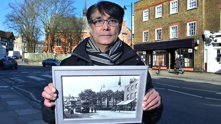Raj Kara-Rajani holds the picture he received from members of the Highgate Society which depicts the