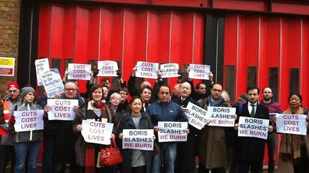 Firefighters protesting before Kingsland Road fire station was axed