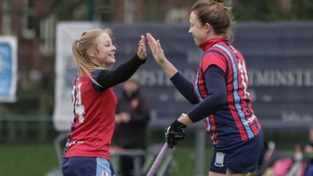 Hampstead & Westminster's Fleur Horner (right) celebrates her goal with Alexandra Irwin. Pic: Martk