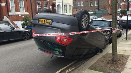 A woman was rescued from the car after it flipped over in a collision in Holmdale Road this morning.