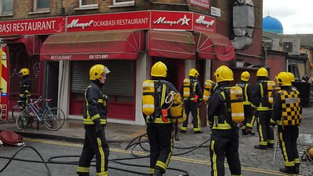 Firefighters tackling the fire in Arcola Street