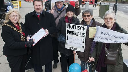 The Mayor of Haringey Cllr Jennifer Mann, signs Hornsey Pensioners Action group's Dignity Action Day