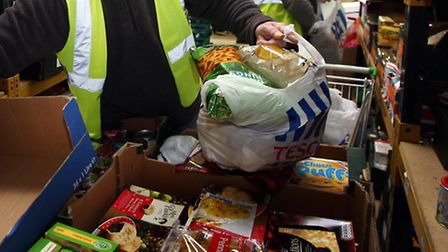 Foodbank volunteers packing food for hungry residents. Picture: David Jones