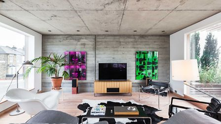 Natural light from floor to ceiling windows softens the exposed concrete surfaces