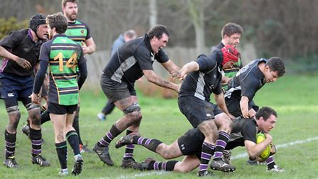 Colm McMahon finishes off a maul to score Belsize Park's fourth try against Grasshoppers and secure
