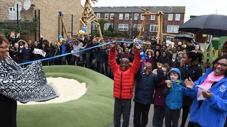 Staff and pupils of St John of Jerusalem celebrating the official opening for their playground