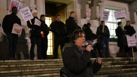 An anti-austerity protest on the steps of the town hall preceeded the meeting
