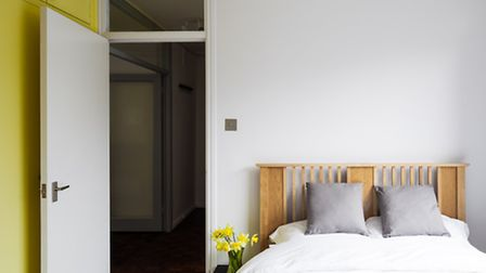 The bedroom follows the simple and functional modernist style