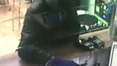 CCTV footage captured the moment the masked robber threatened the member of staff