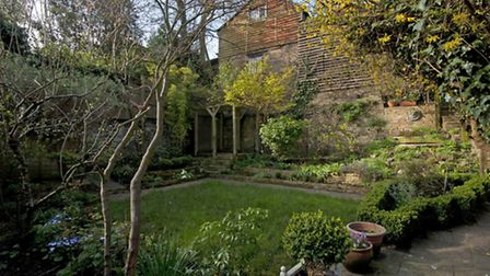 The property has a secluded landscaped back garden