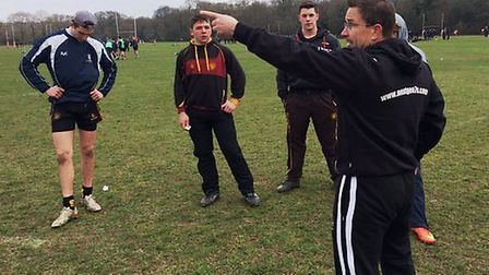 USA head coach Mike Friday issues instructions to the UCS school team at the Rosslyn Park National S