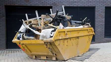 A skip overflowing with waste. PA Photo/thinkstockphotos