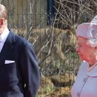 The Queen and Prince Philip open the new Land of the Lions exhibition while a lioness stalks in the