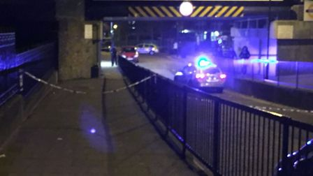 Police taped off the road outside Homerton station. Picture: Harry Kemble