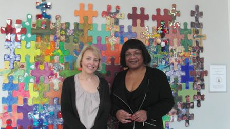 Labour MP Diane Abbott and Pat Quigley, head of The Garden School, in front of the children's artwor