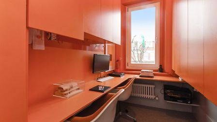 Entire rooms, like this home office, are painted in bright colours